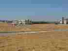 ارض مميزة منطقة الطنيب طريق المطار اطلالة مميزة