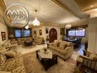شقة دوبلكس ارضية فارغة للبيع ام اذينة مساحة 400م مع حديقة 350م تشطيب سوبر ديلوكس