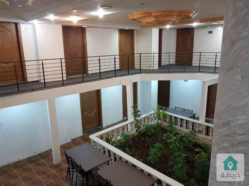 مجمع تجاري استثماري قرب جامعة عمان الاهلية بدخل عالي