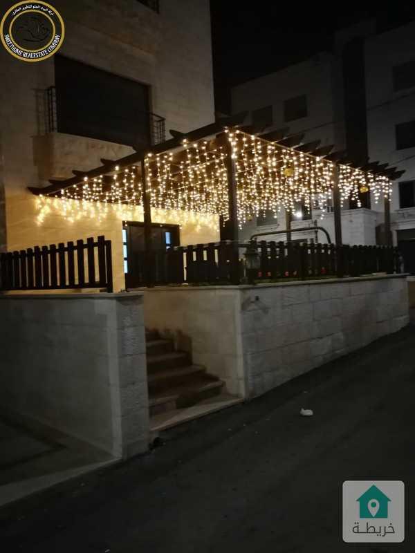 شقة ارضية فاخرة للبيع في دير غبار 180م مع ترس 50م بسعر 158000