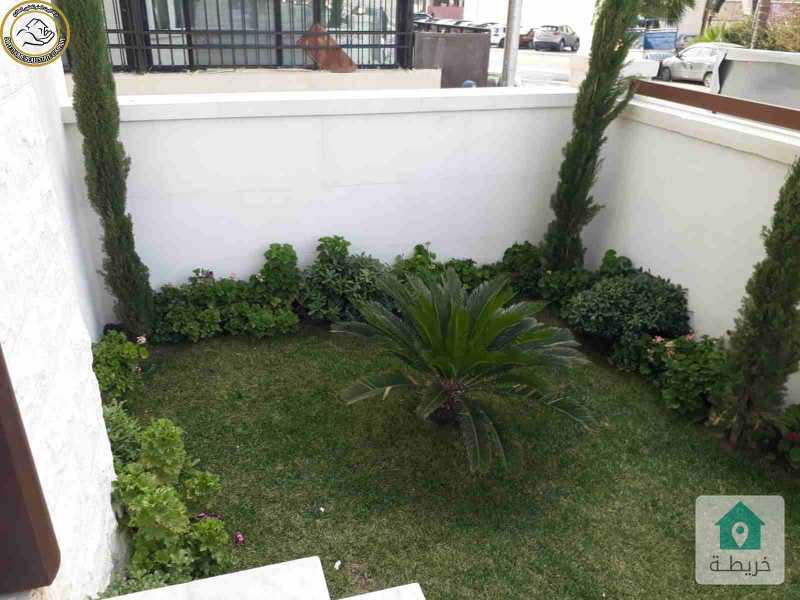 شقة ارضية فاخرة للبيع في تلاع العلي 90م مع ترس وحديقة 50م لم تسكن.