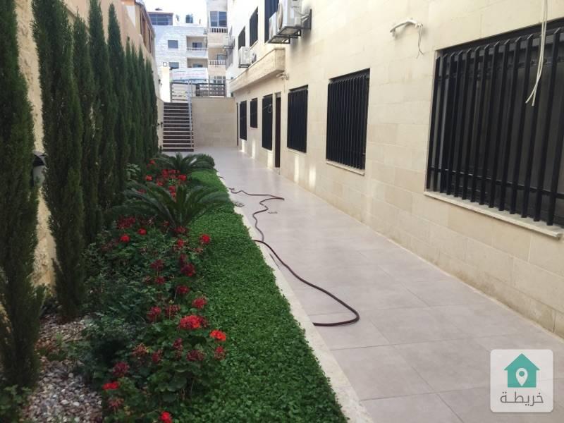 شقة شبة ارضي للبيع في تلاع العلي ٢١٥ متر+ حديقة ١٧٠ متر