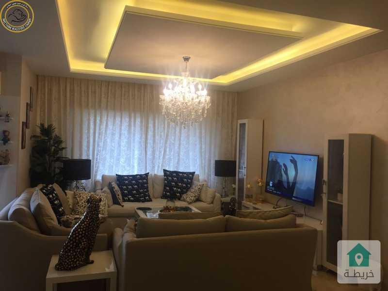 شقة فاخرة للبيع في تلاع العلي طابق ثالث 100م مع روف 100م.