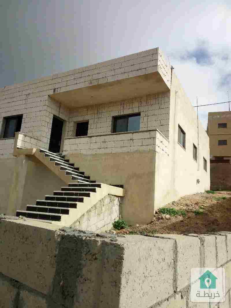 مادبا منزل مستقل واجهة حجر للبيع بسعر 55000 دينار