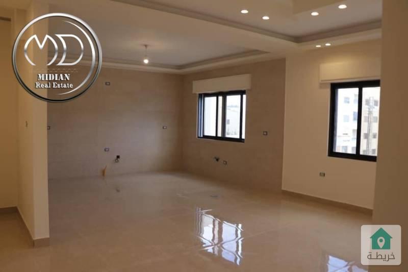 شقة ارضيه جديده - للبيع ضاحية الرشيد - دوار الرضوان مساحة 180و اطلاله رائعه .
