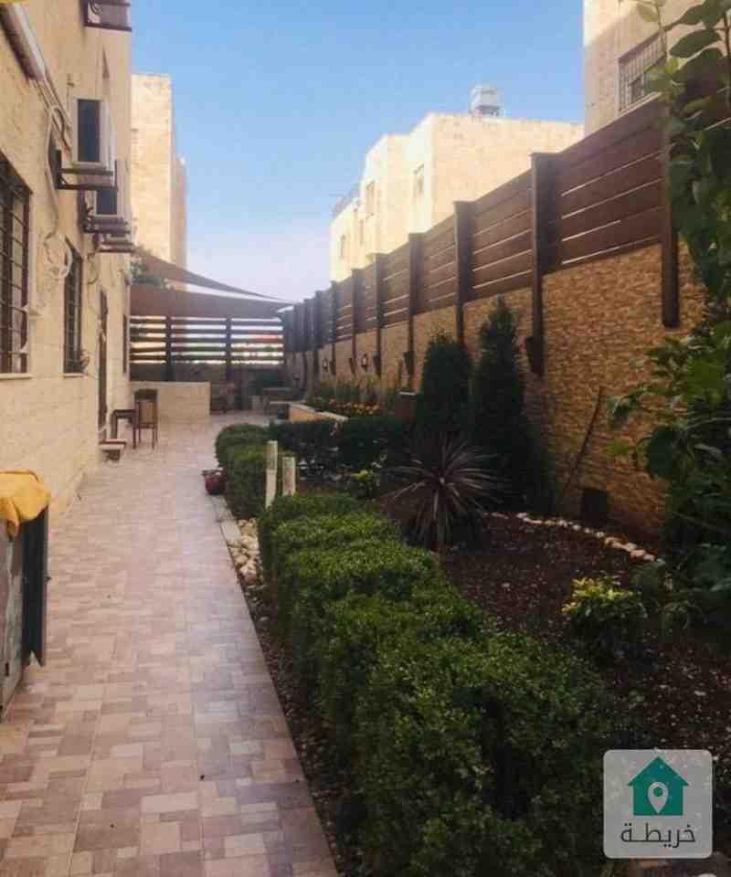 شقة ارضية دوبلكس (ارضية +شبة ارضي) مع حديقة وترسات للبيع في خلدا فاخرة جداً جداً