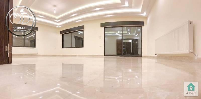 شقة ارضية جديدة - للبيع ضاحية النخيل - مساحة 180م - مع ترس وحديقة 250م .