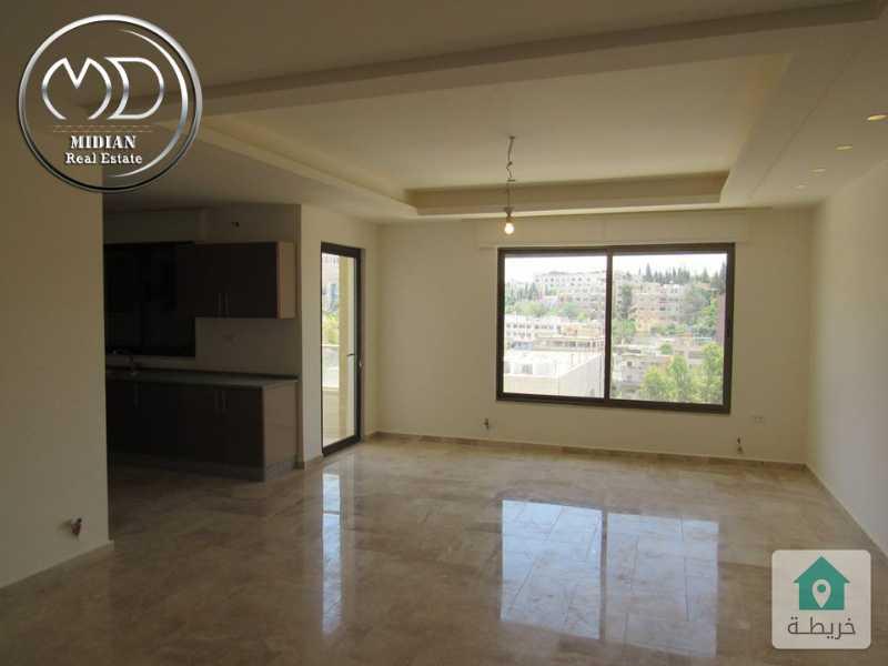 شقة ارضية جديدة للبيع - جبل عمان قرب الدوارالثالث - مساحة 140م مع ترس 90م - وامكانية التقسيط.