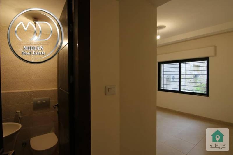 شقة شبه ارضي جديده للبيع دير غبار قرب جونيا مساحة 80م مع ترس 50م بسعر مناسب .
