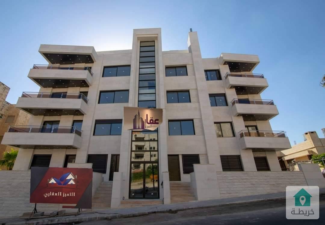 شقة طابق ارضي ١٧٠ م مع ترس ٥٠م للبيع في خلدا قرب المعارف