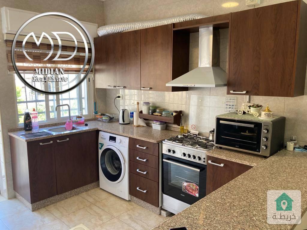 شقة ارضية فارغة للبيع الرابية مساحة 90م مع ترس 75م بسعر مغري