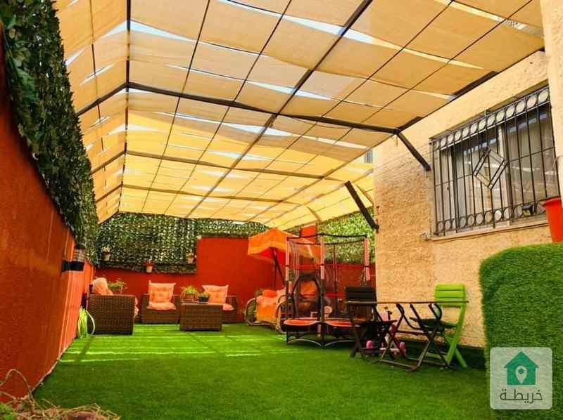 شقة ارضية فخمة جدا للبيع مع حدائق وترسات وكراج خاص في خلدا